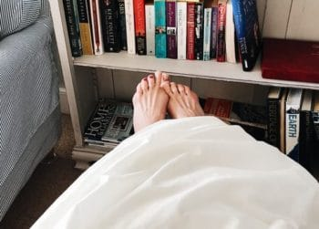 feet hanging off bed